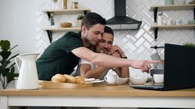 22d72046af Lovely caucasian gay couple, homosexual couple, are hugging and having  breakfast at the dinner