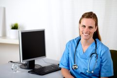 Lovely charming nurse at workplace Royalty Free Stock Photos