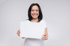 Lovely charming woman advertising positivity stock image