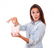 Lovely charming woman with her piggybank Royalty Free Stock Photos
