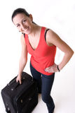 Happy tourist girl with her suitcase Stock Images