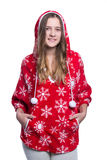 Lovely cheerful teenage girl posing in the studio. Wearing red winter hoodie with snowflakes. Isolated on white background. Royalty Free Stock Image