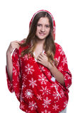 Lovely cheerful teenage girl posing in the studio. Wearing red winter hoodie with snowflakes. Isolated on white background. Stock Images