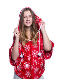 Lovely cheerful teenage girl posing in the studio. Wearing red winter hoodie with snowflakes. Isolated on white background. Royalty Free Stock Photos