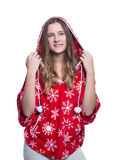 Lovely cheerful teenage girl posing in the studio. Wearing red winter hoodie with snowflakes. Isolated on white background. Stock Photos