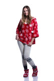 Lovely cheerful teenage girl posing in the studio. Wearing red winter hoodie with snowflakes. Isolated on white background. Stock Photography