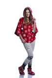 Lovely cheerful teenage girl posing in the studio. Wearing red winter hoodie with snowflakes. Isolated on white background. Stock Image