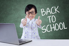 Lovely child back to school and show OK sign Stock Images