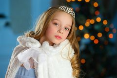 Lovely child in the background of a New Year tree Royalty Free Stock Photography