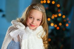 Lovely child in the background of a New Year tree Stock Photography