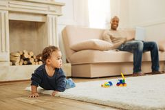 Lovely child crawling on the floor stock images