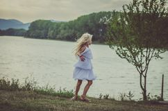 Lovely child dancing at the lake stock photography
