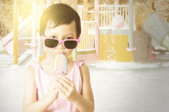 Lovely child enjoy ice cream at pool Royalty Free Stock Photo