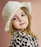 Lovely child girl portrait. Young model posing.Fashion kid close. Lovely child girl portrait. Young model posing in hat and fur coat.Fashion kid closeup Royalty Free Stock Photo