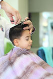 Lovely child at hairdresser Stock Photography