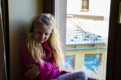 child looking through window. lovely child looking through window stock photo 3