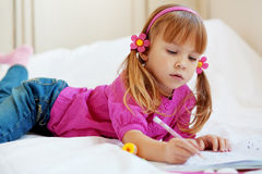 Lovely child painting Stock Image