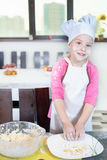 Lovely children preparing a cake Stock Photos