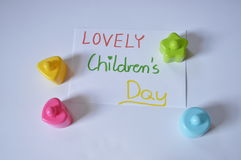 LOVELY Children's Day. Paper with inscription: LOVELY Children's Day, with colored blocks Royalty Free Stock Image