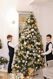 Lovely children twin brothers preparing for celebration of new y Stock Photography
