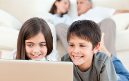 Lovely children watching a movie Royalty Free Stock Image