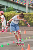 Lovely Chinese girl practicing inline skating, Beijing, China Stock Photo