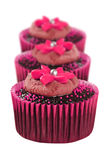 Lovely chocolate cupcakes decorated in pink Royalty Free Stock Image
