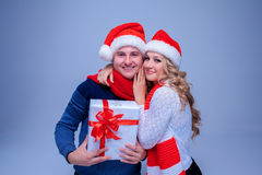 Lovely christmas couple holding presents Stock Photo