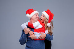 Lovely christmas couple in Santa Claus hats Stock Images
