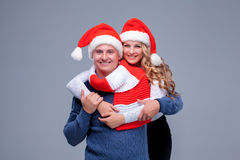 Lovely christmas couple in Santa Claus hats Royalty Free Stock Images