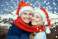 Lovely christmas couple in Santa Claus hats Royalty Free Stock Photography