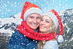 Lovely christmas couple in Santa Claus hats Royalty Free Stock Image