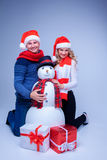 Lovely christmas couple sitting with presents royalty free stock photo