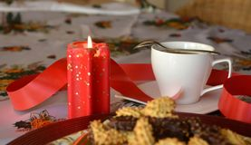 Lovely close up image of Christmas cookies and cup of coffee Royalty Free Stock Image