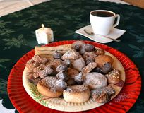 Lovely close up image of Christmas cookies on a plate and coffee cup Royalty Free Stock Image