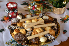 Lovely close up image of Christmas cookies on a table. Christmas cookies with chocolate,nuts and coconut decorated on a table Royalty Free Stock Image