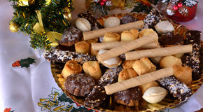 Lovely close up image of Christmas cookies on a table. Christmas cookies with chocolate,nuts and coconut decorated on a table Stock Photo