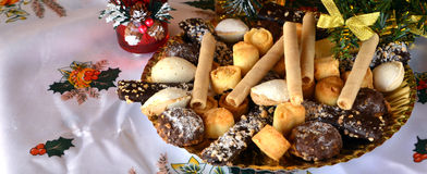 Lovely close up image of Christmas cookies on a table. Christmas cookies with chocolate,nuts and coconut decorated on a table Royalty Free Stock Photo
