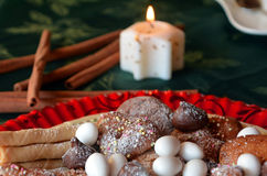 Lovely close up image of Christmas cookies on a table. Christmas cookies decorated on a table with lighted candle Stock Images