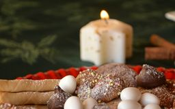 Lovely close up image of Christmas cookies on a table. Christmas cookies decorated on a table with lighted candle Royalty Free Stock Photography