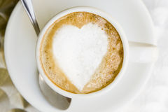Lovely coffee. Heart drawn with the foam in a coffee as a concept of love Royalty Free Stock Image