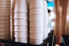 Lovely coffee glasses are standing on the top of the coffee machine in a cozy coffee shop. stock photos