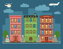 Lovely colorful city downtown landscape with various townhouses,. Clouds, birds, plane and other urban details Royalty Free Stock Photography
