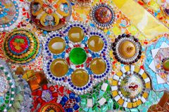 Lovely colorful mosaic designs made with pottery shards and glass gems, at Pha Sorn Kaew, in Khao Kor, Phetchabun, Thailand. Lovely colorful mosaic designs made royalty free stock images