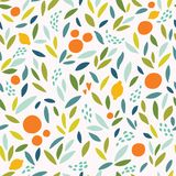 Lovely colorful  seamless pattern with cute oranges, lemons and leaves in bright colors. Royalty Free Stock Images