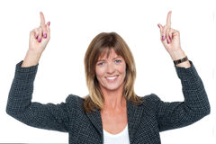 Lovely corporate woman with raised arms Stock Photo