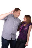 Lovely couple. Young Lovely couple joking isolated on the white background royalty free stock photo