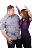Lovely couple. Young Lovely couple joking isolated on the white background Stock Photography