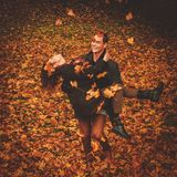 Lovely couple having fun in autumn park Stock Image