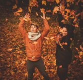 Lovely couple having fun in autumn park Royalty Free Stock Images